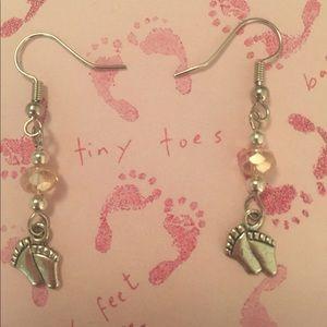 Tiny feet with pink Swarovski crystal beads.